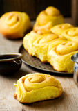 Cinnamon roll with pumpkin and glaze Stock Photo