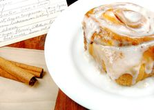 Cinnamon Roll with Recipe. And cinnamon sticks Royalty Free Stock Images
