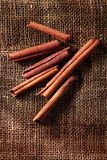 Cinnamon roll sticks. Cinnamon sticks are on a brown canvas and shined with morning lighting Royalty Free Stock Photos