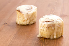 Cinnamon Roll. On wood table Royalty Free Stock Photos