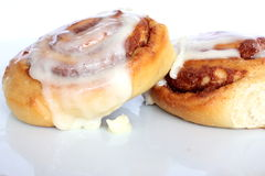 Cinnamon Rolls. Two cinnamon rolls covered with cream cheese icing Stock Images