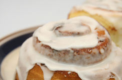 Cinnamon rolls. Close up photo of cinnamon rolls with white icing Stock Photo