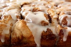 Cinnamon Rolls. Homemade cinnamon rolls dripping with icing Stock Image