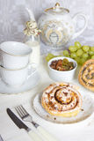 Cinnamon rolls. Morning Cinnamon rolls with pecans Royalty Free Stock Photos