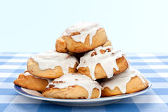 Cinnamon rolls. A plate of delicious cinnamon rolls coated with sugary frosting glaze Stock Photo