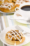 Cinnamon Rolls. Fresh hot cinnamon rolls straight from the oven with a coffee Royalty Free Stock Image