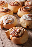 Cinnamon rolls with almond close up on the table. Vertical Stock Images