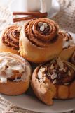 Cinnamon rolls with almond macro on a plate and coffee. vertical Stock Image