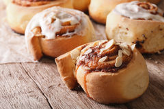 Cinnamon rolls with almond macro on the table. horizontal Stock Photos