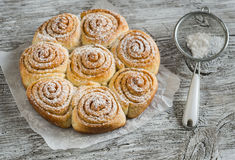 Cinnamon rolls. On bright wooden surface Stock Images