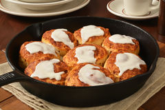 Cinnamon rolls in a cast iron skillet. Home baked cinnamon rolls in a cast iron skillet with icing Royalty Free Stock Images