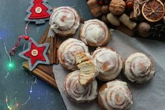 Cinnamon rolls for Christmas. Christmas cakes. Home baking cinnamon rolls for the new year and Christmas holidays. royalty free stock images