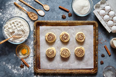 Cinnamon rolls or cinnabon handmade raw dough preparation sweet traditional dessert Royalty Free Stock Images