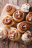 Cinnamon rolls close up on the table. vertical top view Stock Images