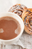 Cinnamon rolls with cocoa Stock Photos