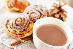 Cinnamon rolls with cocoa Stock Image
