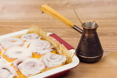 Cinnamon rolls with coffee Stock Images