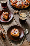 Cinnamon rolls with cream icing Royalty Free Stock Images