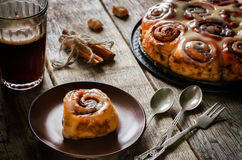 Cinnamon rolls with cream icing Stock Photo