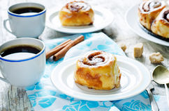 Cinnamon rolls with cream icing Royalty Free Stock Photography
