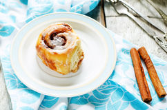 Cinnamon rolls with cream icing Stock Photos