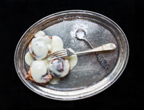 Cinnamon rolls with cream icing and sugar powder on a metal dish Royalty Free Stock Images