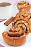 Cinnamon rolls and a cup of coffee. Freshly baked cinnamon rolls served with a cup of coffee Royalty Free Stock Photo