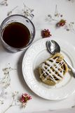 Cinnamon rolls with the cup of coffee royalty free stock photography
