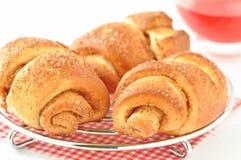 Cinnamon rolls and fruit tea Stock Photo