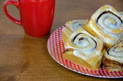 Cinnamon rolls on gingham plate Royalty Free Stock Photo