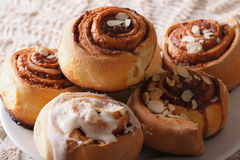 Cinnamon rolls with icing close-up on a plate. horizontal Stock Image