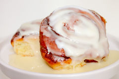 Cinnamon Rolls and Icing Stock Photography