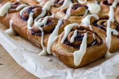 Cinnamon rolls with icing Stock Photos