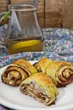 Cinnamon rolls. And lemon tea stock image