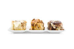 Cinnamon rolls with luxury topping Stock Photos