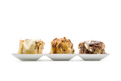 Cinnamon rolls with luxury topping Stock Image