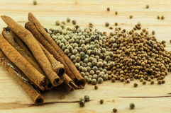 Cinnamon rolls & pepper Stock Photos