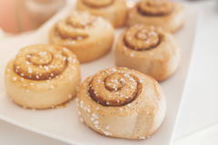 Cinnamon rolls on white plate. Royalty Free Stock Images
