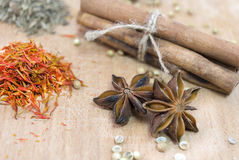 Cinnamon, safron, star anise and peper on a wooden table Royalty Free Stock Image