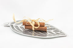 Cinnamon on silver. Three pieces of cinnamon on a sheet of silver tree Stock Photos