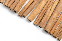 Cinnamon. Some cinnamon sticks  on white background. Copy space Royalty Free Stock Images