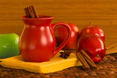 Cinnamon Spiced Apple Cider ~ Spiced Wine and Red. And Green Apples Royalty Free Stock Photo