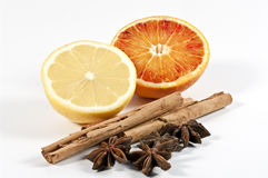 Cinnamon, star anise and citrus fruits Royalty Free Stock Photo