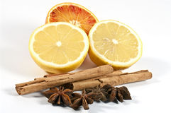 Cinnamon, star anise and citrus fruits Royalty Free Stock Photography