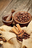 Cinnamon, star anise and coffee beans. On old wooden table Stock Photo