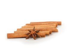 Cinnamon and star anise, isolated on white Royalty Free Stock Photos