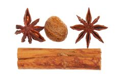 Cinnamon, star anise and nutmeg. Isolated against white stock image