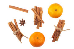 Cinnamon, star anise and orange on white. Background Royalty Free Stock Images