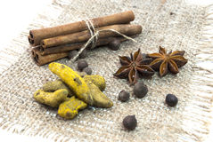Cinnamon, star anise and peper on a wooden table Royalty Free Stock Photography