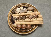 Cinnamon, star anise, rock sugar, macadamia nuts, nuts pecans, almonds, peanuts Royalty Free Stock Photography